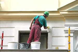 man-painting-house-exterior | Munster Gutter Cleaning