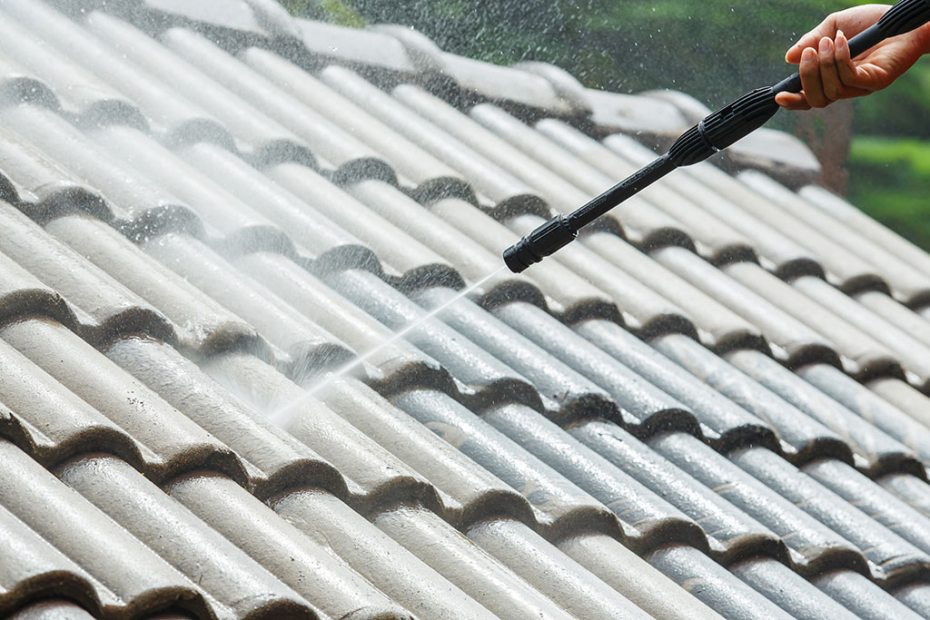 power-washing-roof-tiles-of-house