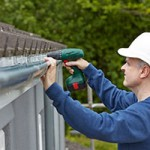 workman-replacing-guttering-on-exterior-of-house